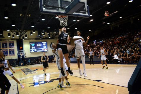 Power forward Trumann Gettings throws down a dunk against Sierra Canyon. The Wolverines lost, 75-65. Credit: Kyle Reims/Chronicle