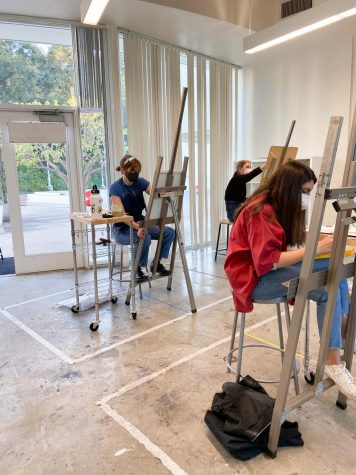 Students enrolled in various visual arts courses reconnect with their peers in the same classroom on campus again, but this time requiring masks and social distancing.