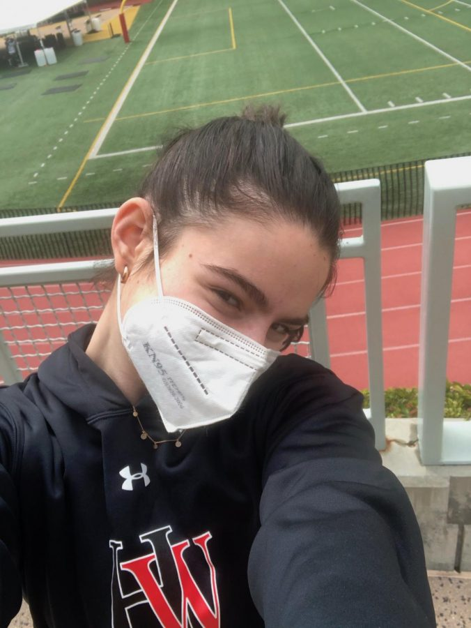 Natalie Cosgrove '23 poses for a selfie by Ted Slavin Field.