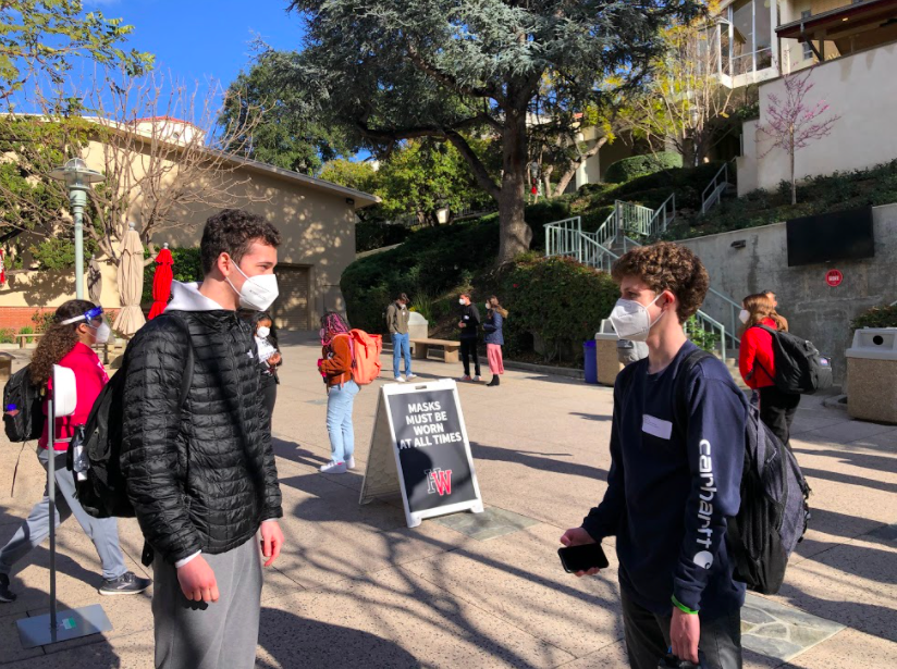 Chronicle Editor-in-Chief Ethan Lachman '21 and William Ruden-Sella '21 chat on the quad with proper social distancing.