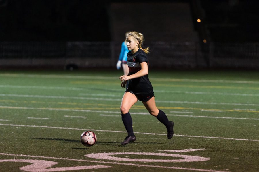 Defender Natalie Phillips '21 looks to pass the ball to her teammate at a match last season against Hart High School.