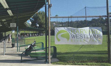 Varsity golf team members practice alongside community members after school at Weddington.