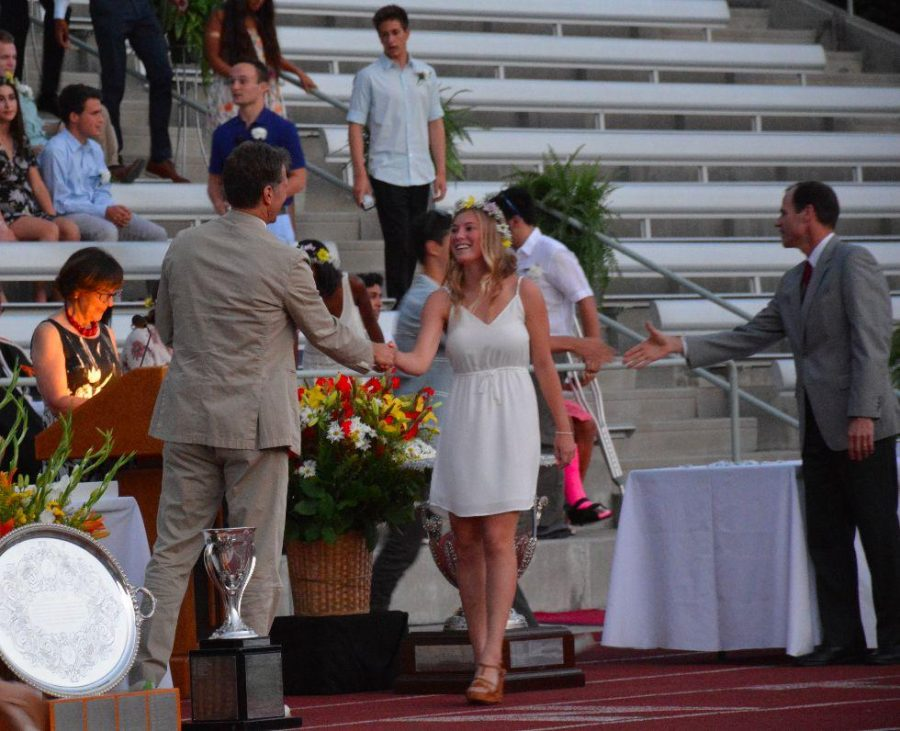 Caitlin Neapole 16 shakes the hand of Head of Upper School Audrius Barzdukas after receiving her ring at the annual Ring Ceremony. Credit: Danielle Spitz/Chronicle