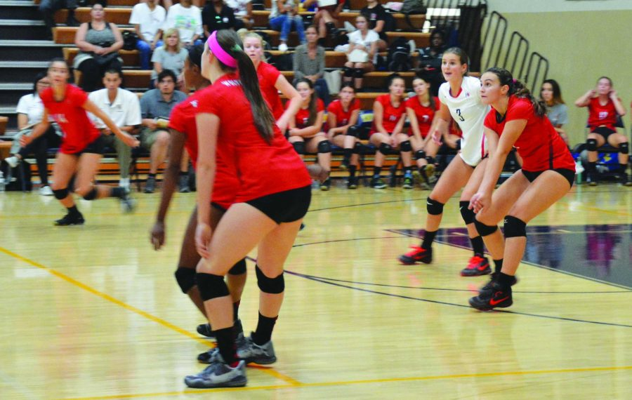 Bella Headley, right in red, prepares to pass in the volleyball teams 3-0 win at Notre Dame on Sept. 29. Credit: Dario Madyoon/Big Red