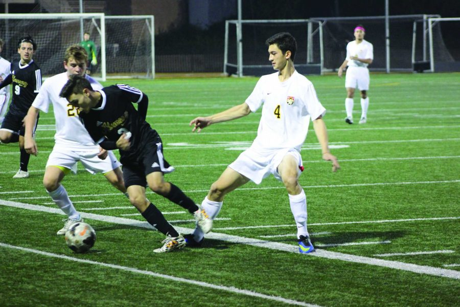 Jon Nelson '16 (left) plays varsity soccer and last year took all honors classes. Credit: Henry Vogel/Big Red