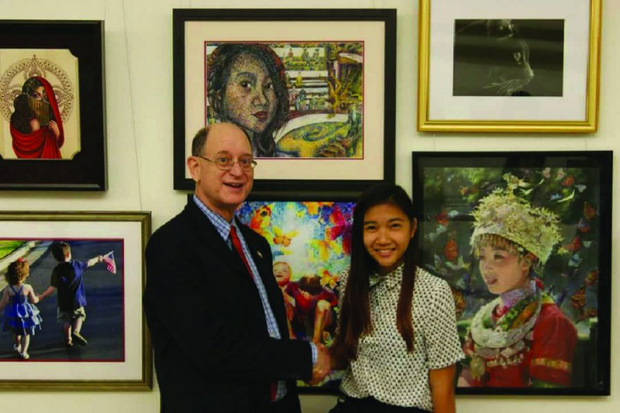 Samantha Ho '16 stands next to Congressman Brad Sherman under her pastel self-portat titled