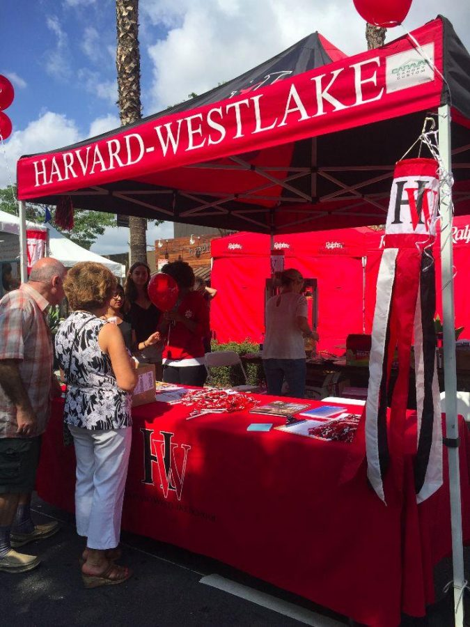 Harvard-Westlake officials worked a booth at the Sherman Oaks Street Fair Sunday. Credit: Katie Plotkin/Chronicle