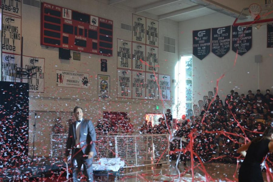 Head of Upper School Audrius Barzdukas performs during the Homecoming pep rally. Credit: Jesse Nadal/Chronicle
