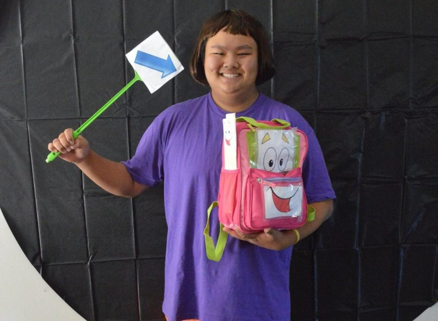 Matthew Jung '16, dressed as Dora the Explorer, takes his picture for judging for Social Committee's Halloween costume contest. Jung has won two years in a row. Printed with permission of the Social Committee