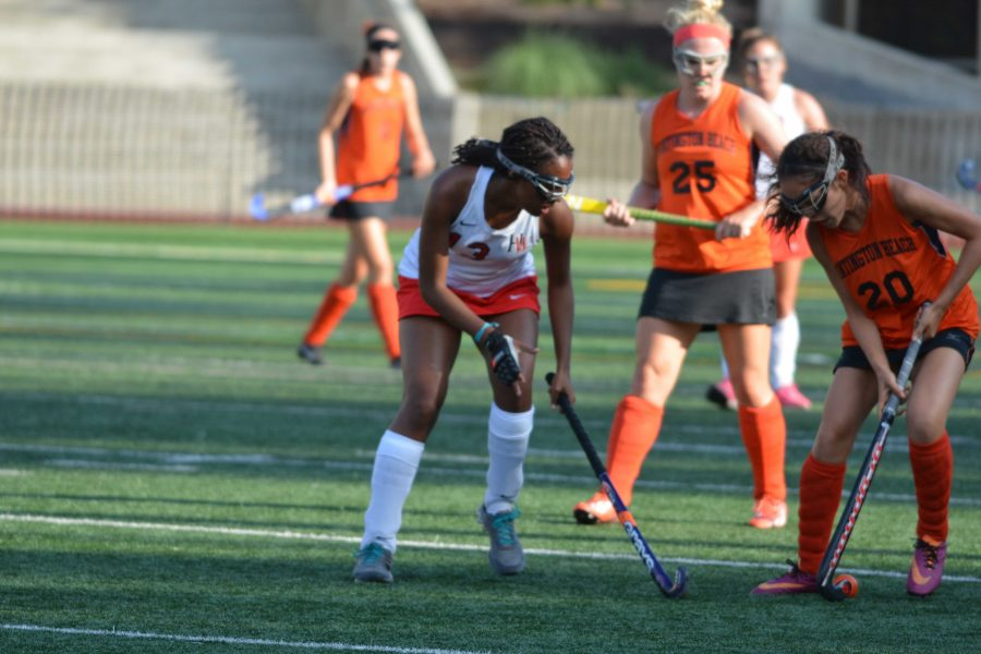 Stick it: Phaedra Robinson runs down the field in the Wolverine's game against Huntington Beach.  Credit: Carina Marx
