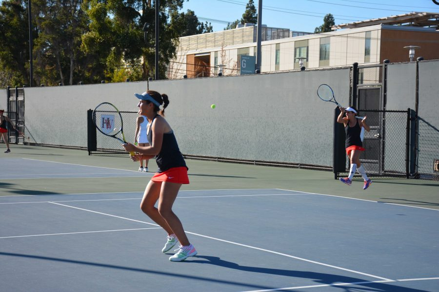 Double up: Amanda Chan and Jenna Moustafa return a hit during a match against Notre Dame.  Credit: Emily Rahal