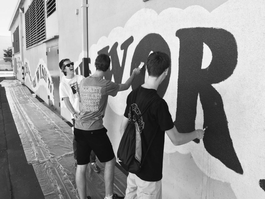 Andrew Berg '17, Justin Ciccone '17 and Michael Stokdyk '17 paint a mural at Bethune School. Credit: Joe Levin/Chronicle