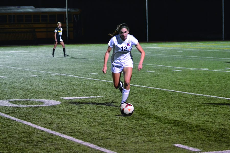 Forward Paige Howard '17 takes the ball forward during a game. Credit: Carina Marx/Big Red