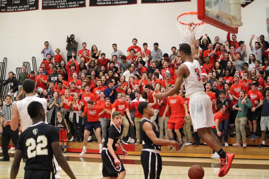 The fanatics section explodes in Taper gym as Cassius Stanley '19 throws down a dunk during a game against the Heritage Christian School Warriors. Credit: Cameron Stine/Big Red