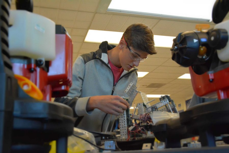 Cameron Schiller '18 builds robots for the Harvard-Westlake robotics team. Credit: Brittany Hong/Chronicle