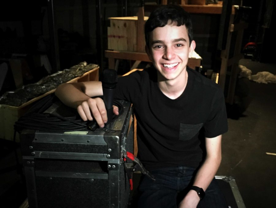 Daniel Lesh'18 spends a lot of time backstage moving equipment or setting up speakers. He even has his own office on campus.  Credit: Alena Rubin/Chronicle