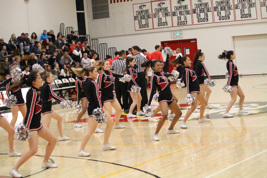 The cheerleading squad performs at halftime of the boys' basketball game. Credit: Cameron Stine/Big Red