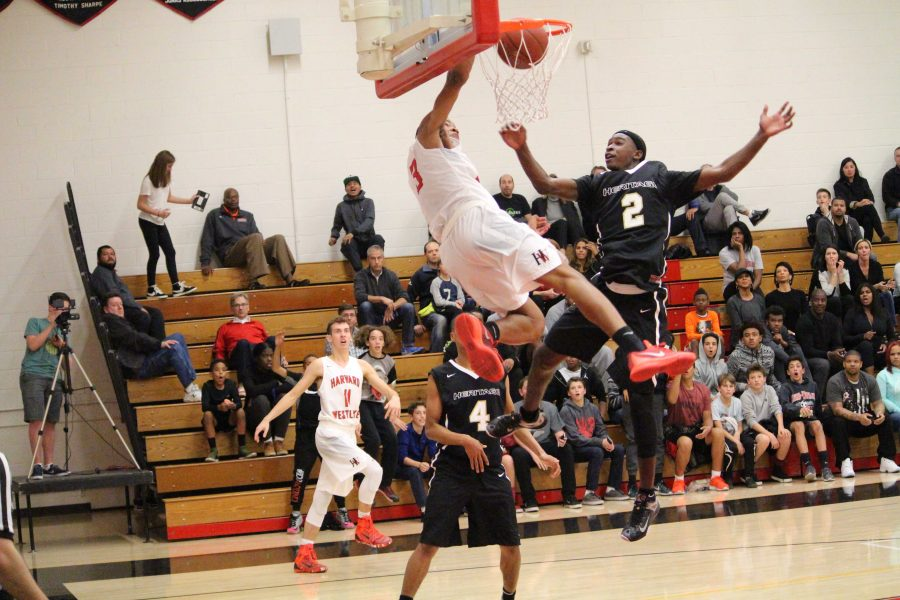 Cassius Stanley '19 dunks on Juhwan Harris-Dyson '17 in the fourth quarter. Credit: Cameron Stine '17/Chronicle