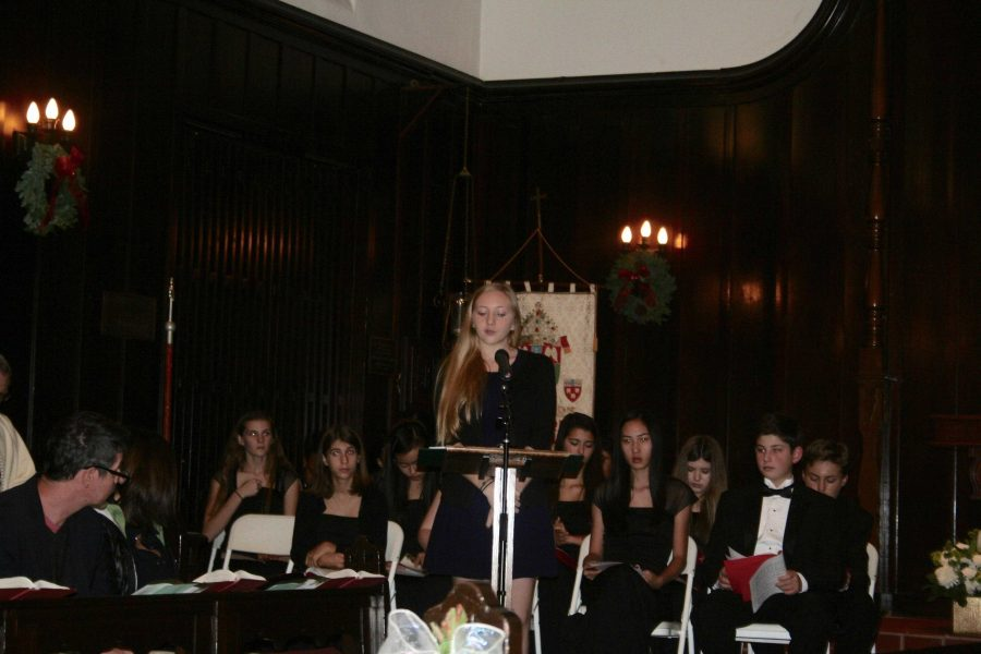 Prefect Lexi Block '17 reads a biblical passage at this year's Christmas Convocation. Credit: Claire Dennis/Chronicle