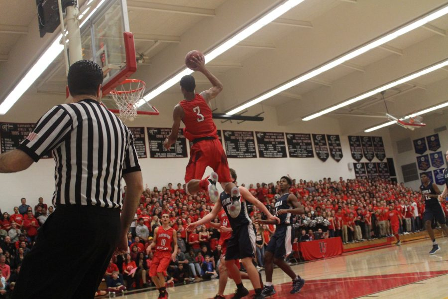 Cassius Stanley '19 goes up for an alley oop from Wolfgang Novogratz '16 during the fourth quarter. Credit: Dario Madyoon '17/Chronicle
