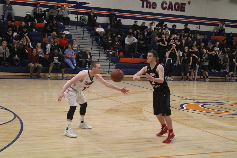 Henry Vogel 16 passes the ball to an open teammate during the third quarter of the game.  Credit: Bennett Gross 16/Chronicle