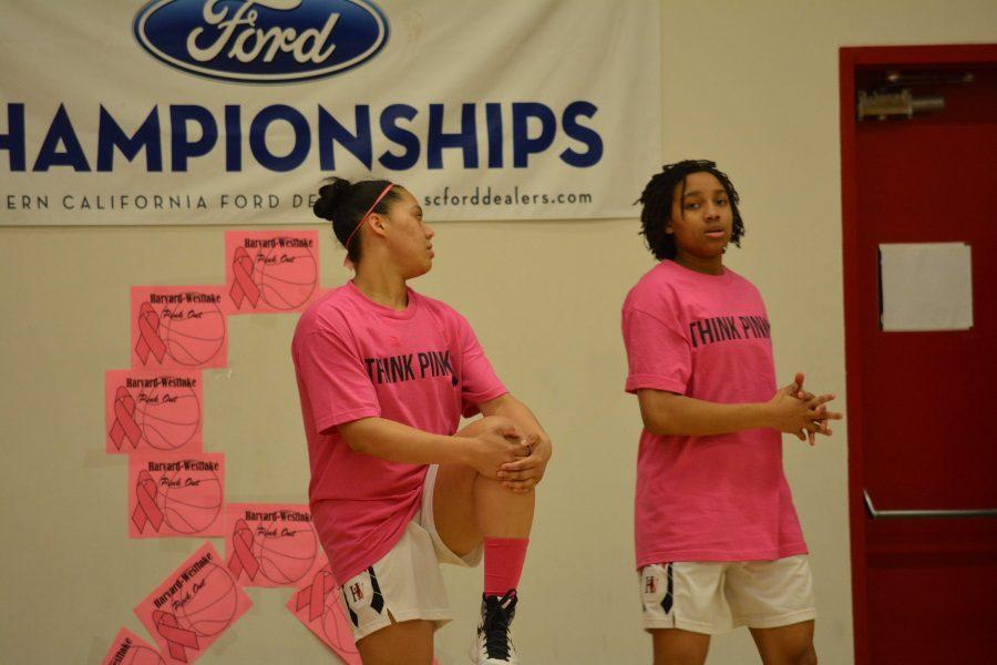 Lauren  Lapesarde '17 and Jayda Rufus-Milner '18 warm up befroe the ThinkPink game.  Credit: Rian Ratnavale/ Chronicle