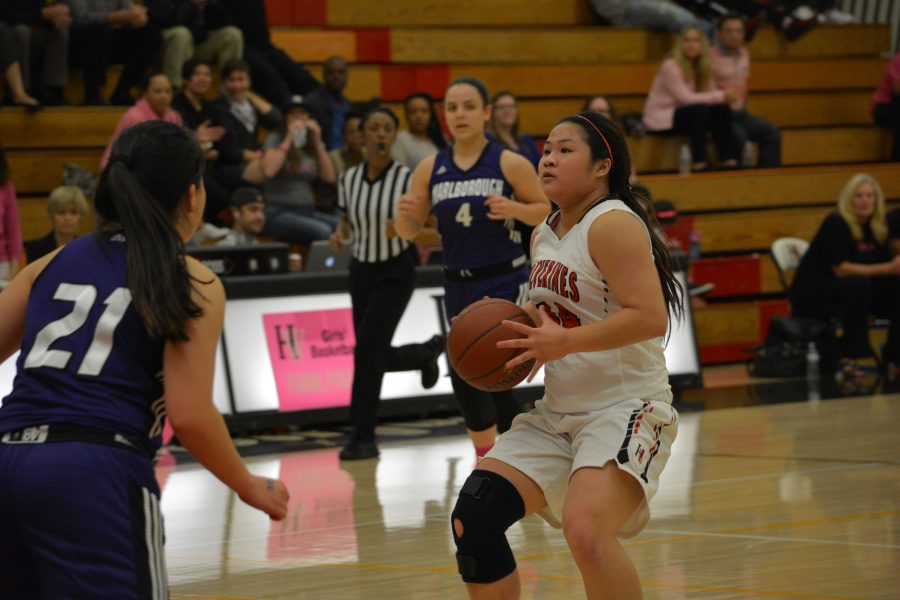 Lindsey Tse '16 prepares to shoot the ball in a 74-24 victory over Marlborough Jan. 26.