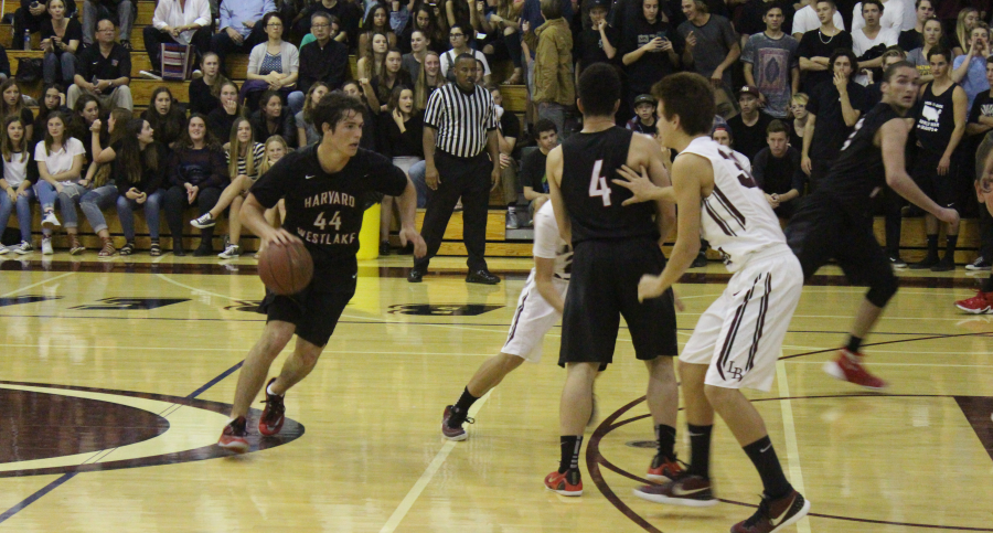 Point guard Wolfgang Novogratz 16 dribbles around a screen set by teammate Carter Begel 17 during the third quarter of the game. Credit: Bennett Gross 16/Chronicle