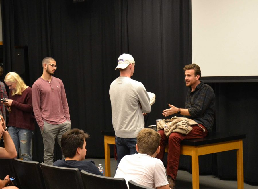 "Jason Segel '98 talks with McCabe Slye '16 following the showing of his movie ""The End of the Tour"" Sunday. Segel visited performing arts teacher Ted Walch's Cinema Sundays to discuss the movie and answer questions from students and faculty. Credit: Lauren Kim/Chronicle"