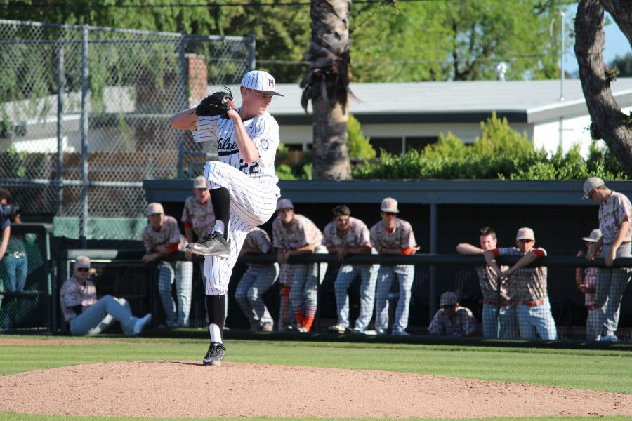 McCabe Slye 16 focuses on the plate mid-windup in his two-hit complete game.  Credit: Bennett Gross 16/Chronicle