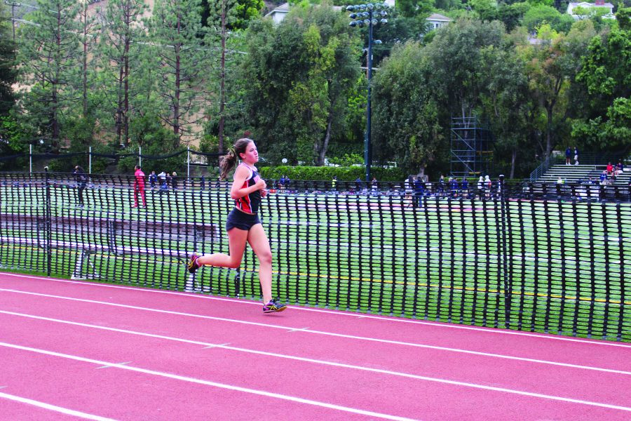 Casey+Crosson+competes+in+a+track+and+field+event+in+a+recent+meet.+Credit%3A+Emily+Rahhal%2FChronicle.
