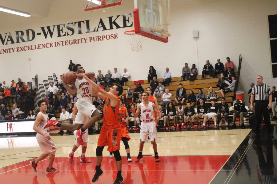 L Simpson 19 drives to the basket during the second half of the game.  Credit: Cameron Stine 17/Chronicle