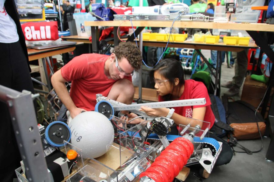 Wafflebots members Johnny Berman '17 and Samantha Ho '17 work on the team's robot, 1148, in preparation for their first competition. Printed with permission of Isobel Phillips