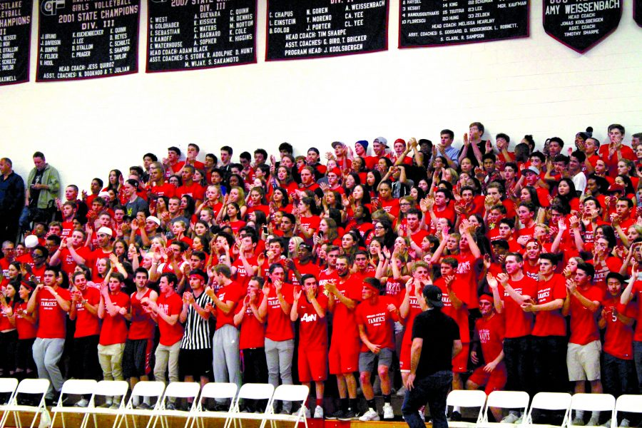 The Harvard-Westlake section cheers for boys' Varsity basketball led by Head Fanatics in a game against Notre Dame in the CIF playoffs Feb. 26. The Wolverines lost 56-54, taking them out of the running for the CIF championship. Credit: Kelly Loeb