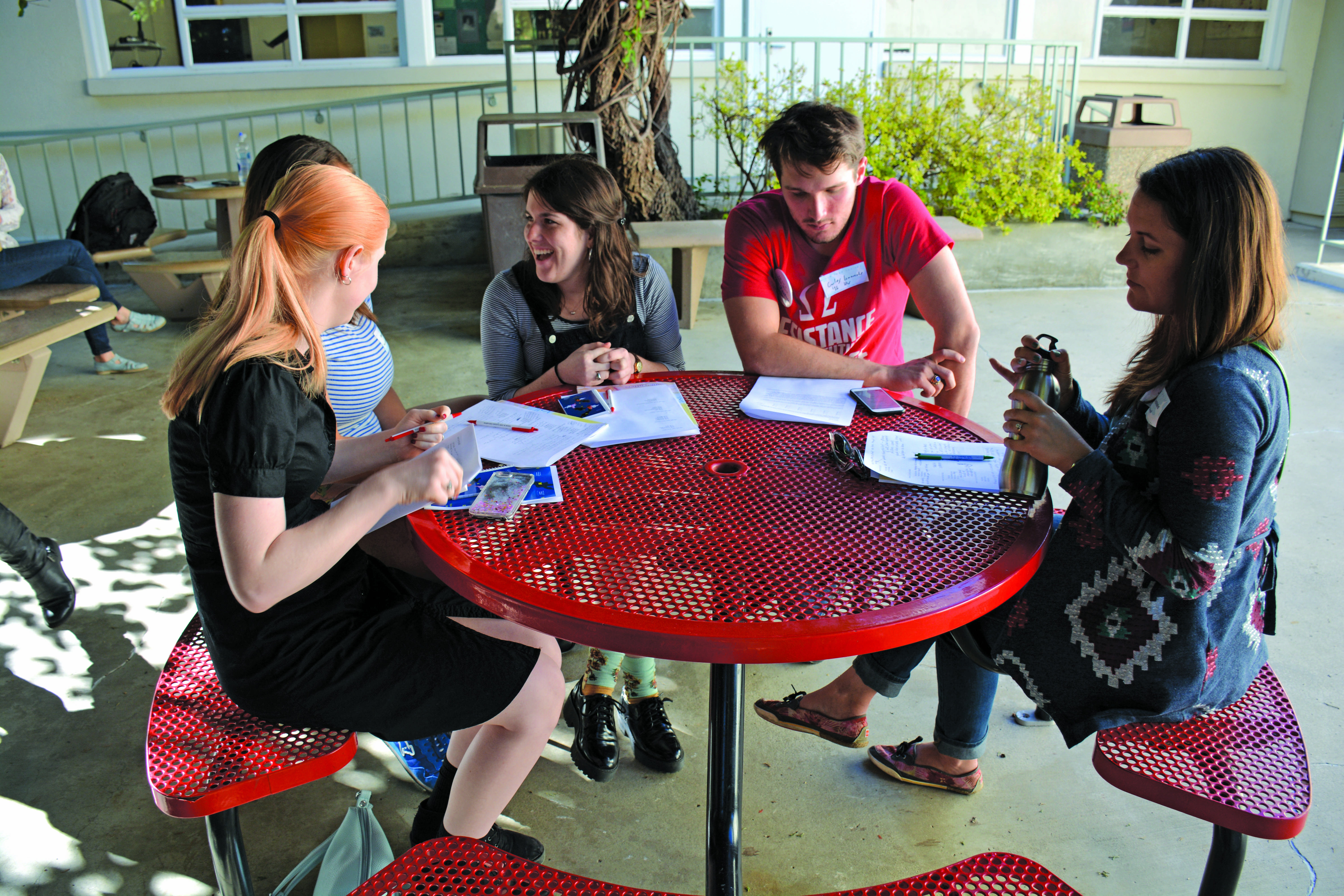 CREATIVE PROCESS: Students brainstorm with each other just outside of Rugby. Credit: Teresa Suh/Chronicle