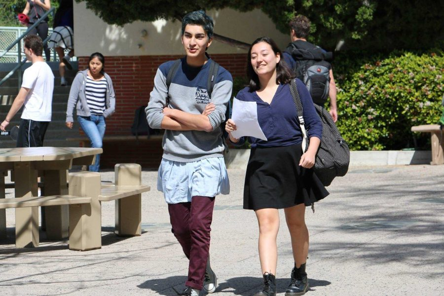 Matteo Lauto '18 and Sakura Price '18 walk to class wearing skirts as part of a La Femme Club event to promote Women's History Month and spread awareness for rape prevention. Printed with permission of Sohni Kaur