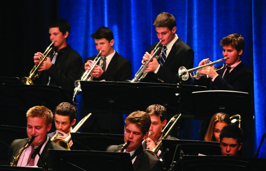 SOUND THE HORNS: Students show off their musical skills during their spring concert. The annual showcase was held April 20 at the Upper School in Rugby Theater.