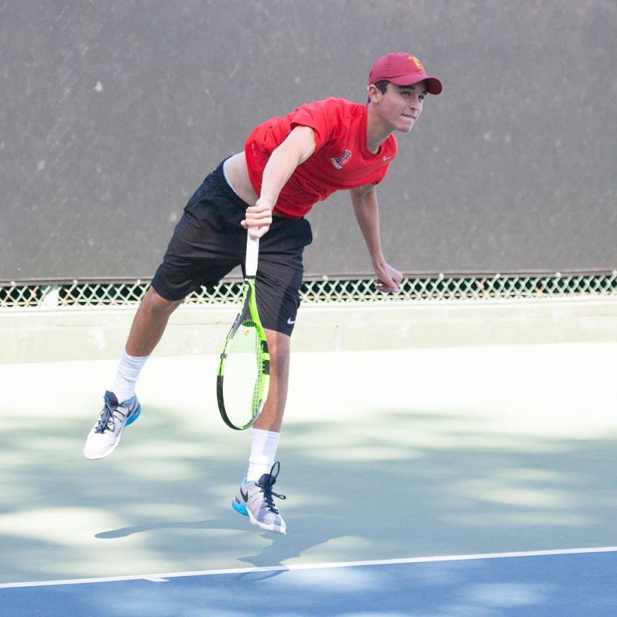 Adam Straberg '17 serves a ball during a match against St. Francis. The team went on to win 14-4. / Photo  printed with permission of HW Athletics