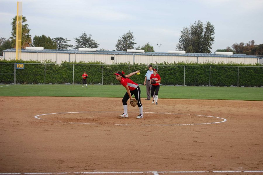 Hailey de la Vara '17 winds up for a pitch during the Wolverines' game against Windward.  Credit: Adam Yu/ Chronicle.