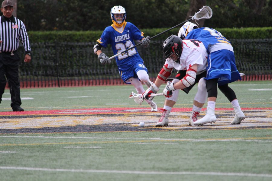 Philip Thompson '16 wins a ground ball in a 6-5 Wolverine victory over Agoura Hills High School in triple overtime.   Credit: Dario Madyoon/ Chronicle