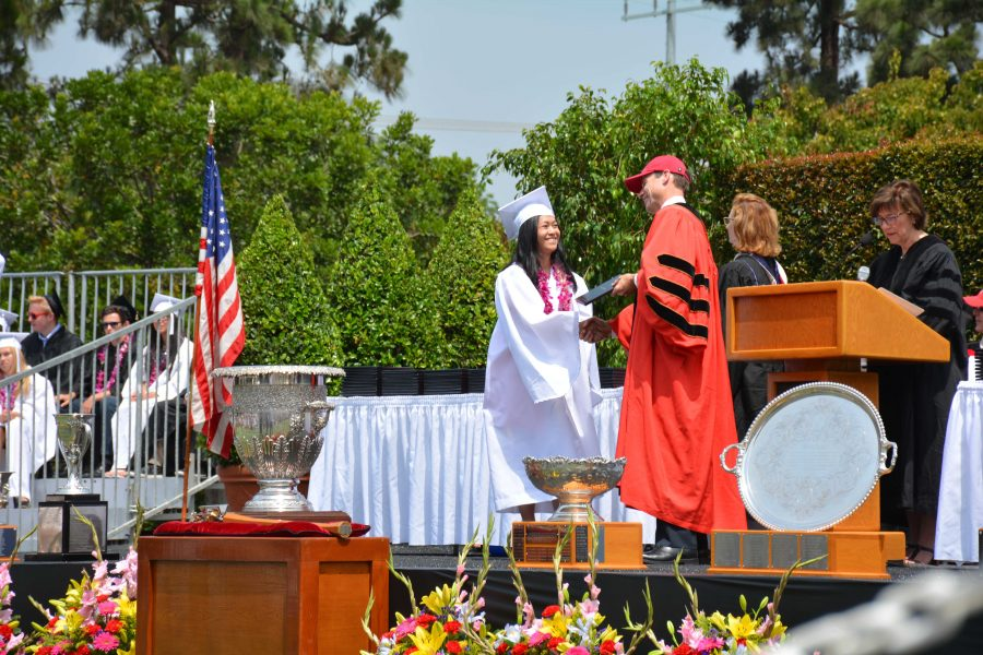Sharon Chow '16 receives her diploma from President Rick Commons at the commencement ceremony Friday. Credit: Danielle Spitz/Chronicle