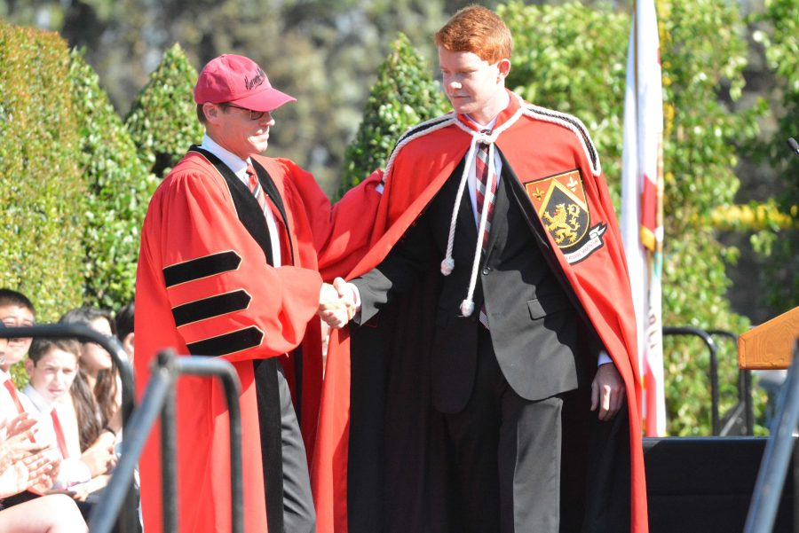 President+Rick+Commons+shakes+Head+Prefect+Matt+Thomass+17+hand+after+Thomas+concludes+his+speech+at+the+fourth+annual+convocation+ceremony.+Credit%3A+Aaron+Park%2FChronicle