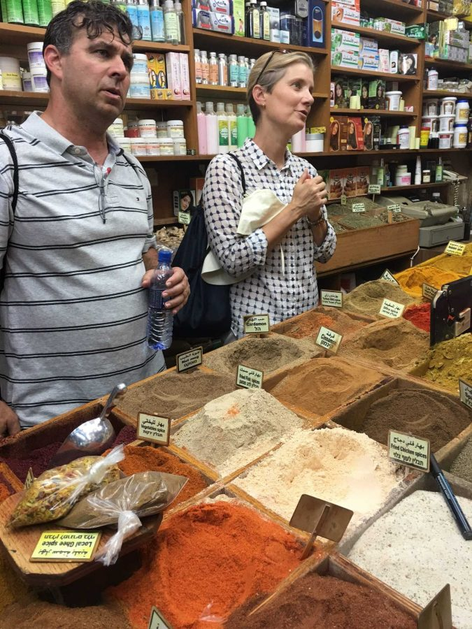 History teachers Larry Klein and Katherine Holmes-Chuba speak to a shopkeeper in an Israeli spice market. Sixteen faculty members spent two weeks in Israel on an Immersion Faculty Fellowship to experience the culture. Printed with permission of Cheri Gaulke