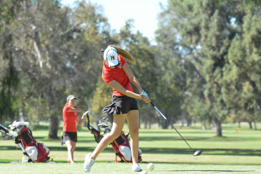 Claire Dennis '18 tees off during the girls' golf season opener against FHSA.  The team won 210-258, while Dennis shot 8-over 45.  Credit: Aaron Park/Chronicle