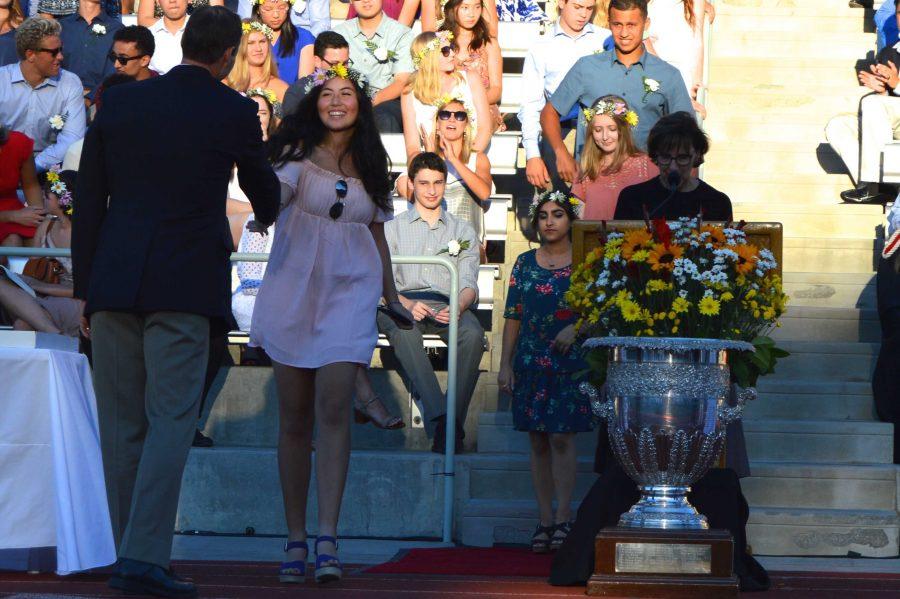 Emma Kateman '17 shakes President Rick Commons's hand before receiving her senior ring on Sept. 11. Credit: Sophie Haber/Chronicle