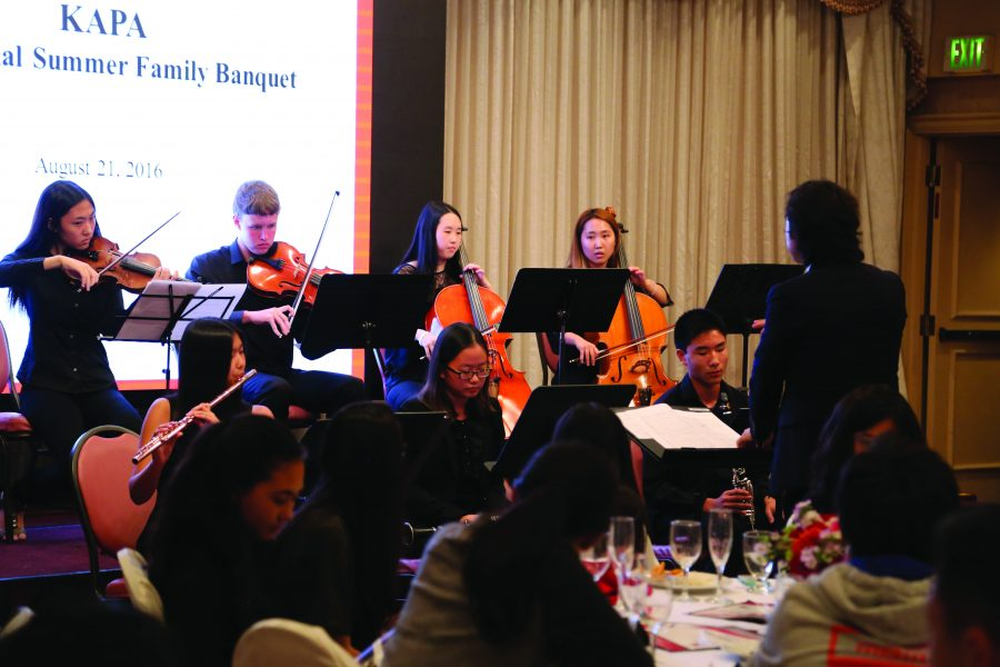 Members of Soma, a musical group that aids the disabled through music, preview an upcoming performance at the Korean American Parent Association's annual dinner. The group performed again Saturday and donated profits to charity. Printed with permission of Chad Yoon.