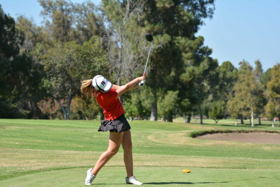 Josie Baker '18 tees off during the Wolverines' 210-303 victory over Chaminade on Sept. 8.  Credit:  Aaron Park/ Chronicle