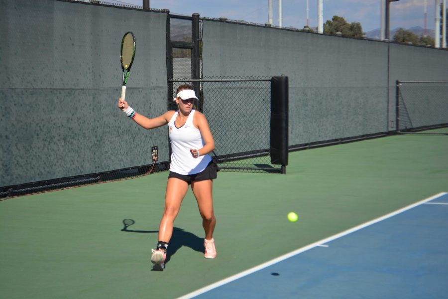 Jennifer+Gadalov+%E2%80%9919+prepares+to+hit+the+ball+to+her+opponent.+The+Wolverines+lost+the+game+11-7+to+Notre+Dame.+Credit%3A+Ellis+Becker%2F+Chronicle