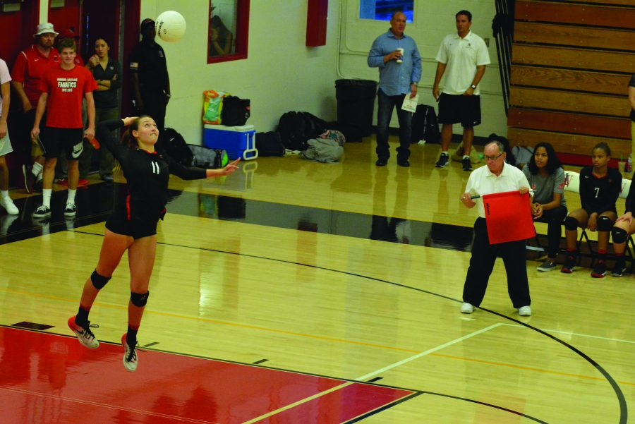 Outside+hitter+Pearl+Acord+%2717+spikes+the+ball+over+the+net+against+Marymount+High+School+in+a+3-0+loss.+Credit%3A+Aaron+Park%2FChronicle