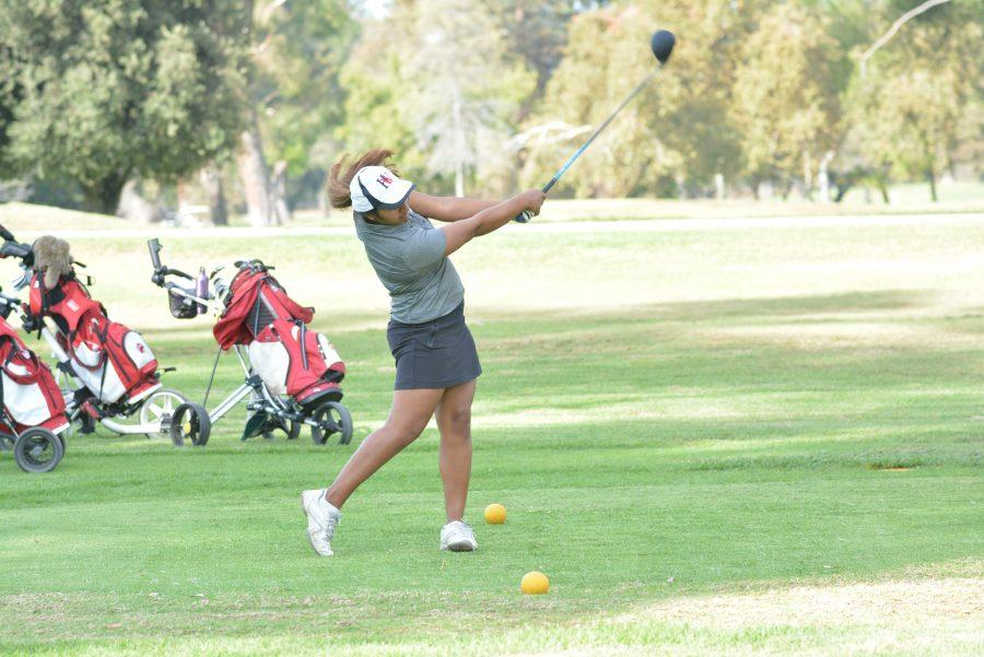 Rachel Madhogarhia '17 tees off during the Wolverines' 200-305 victory over the Alemany Warriors on Oct. 14.  Credit: Aaron Park/ Chronicle